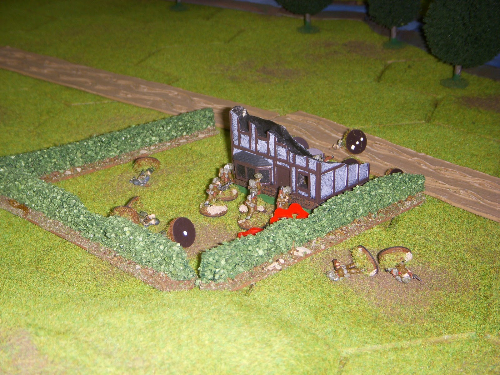 Then they captured the objective by the road to force the Germans to retreat.