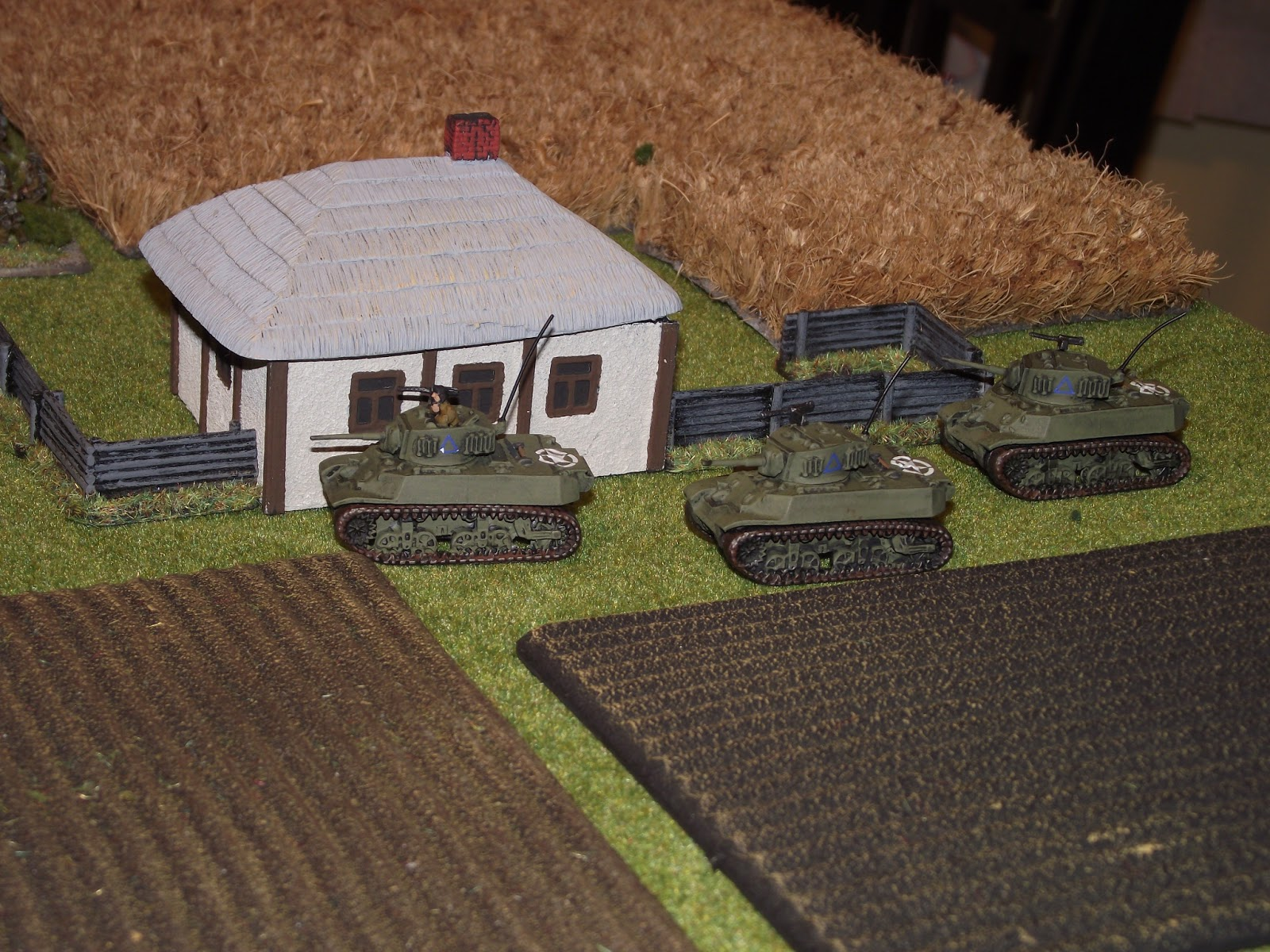 British recce tanks checking out the outer farm houses.