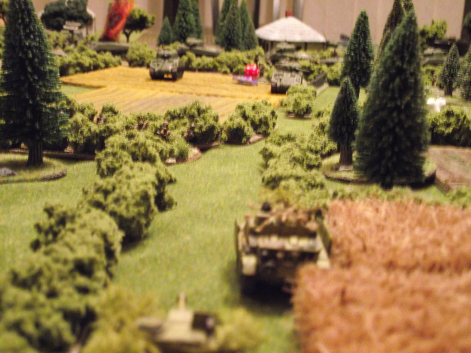 StuG's exchanging fire with 2 Shermans. We managed a couple of hits each, but no major damage done.