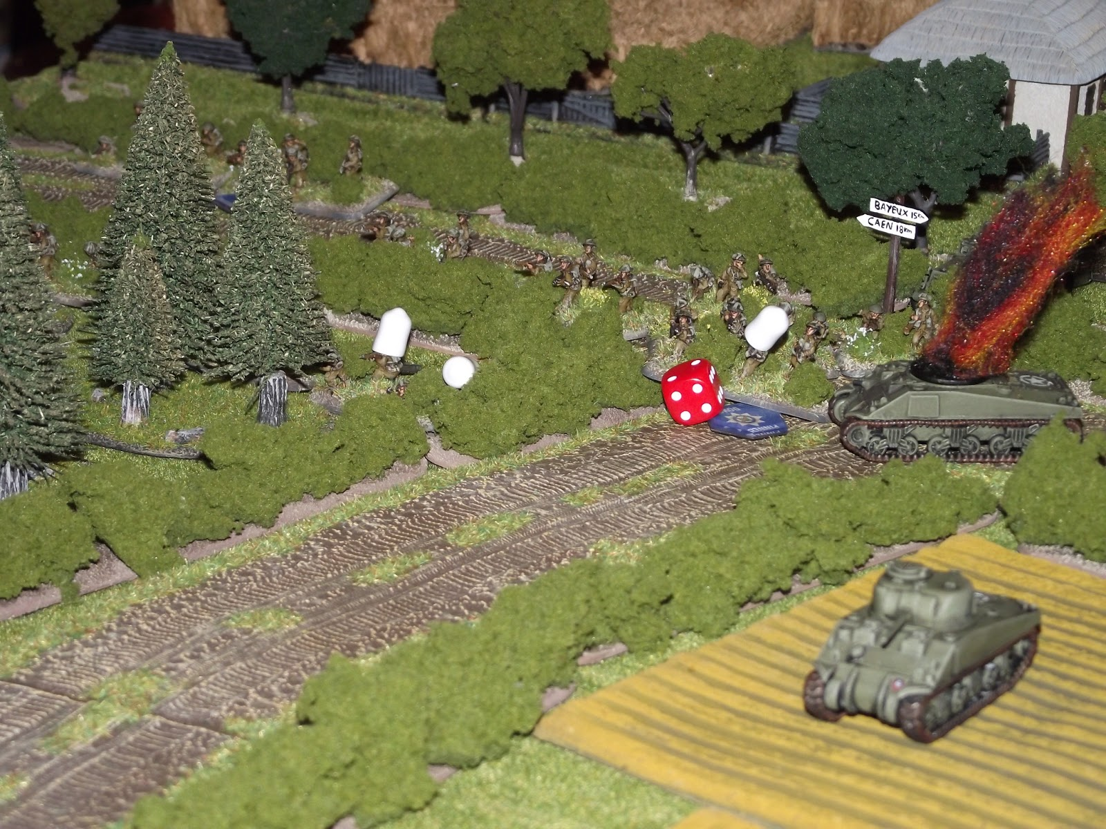 A silly British squad manages to find some open ground (road), but its torn apart by MG42 fire.