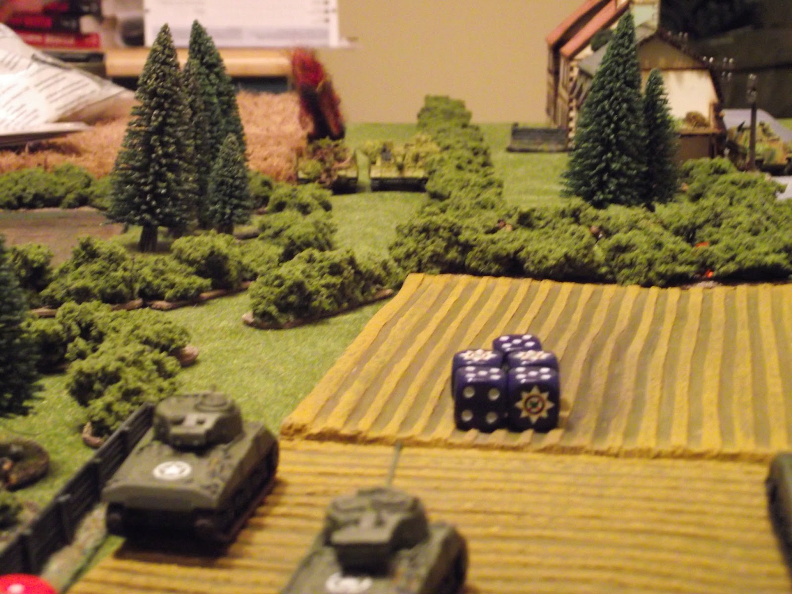 The StuG platoon manages to hit the Sherman on the right twice, but only managed to do some minor engine damage. The return fire from that same Sherman blew up the StuG on the left with a 5-0 score. The Firefly managed to knock out the 10.5cm StuG's gun out and destroy its optics, while the other Sherman (off screen) damaged the StuG's engine. A VERY good round of shooting for me.
