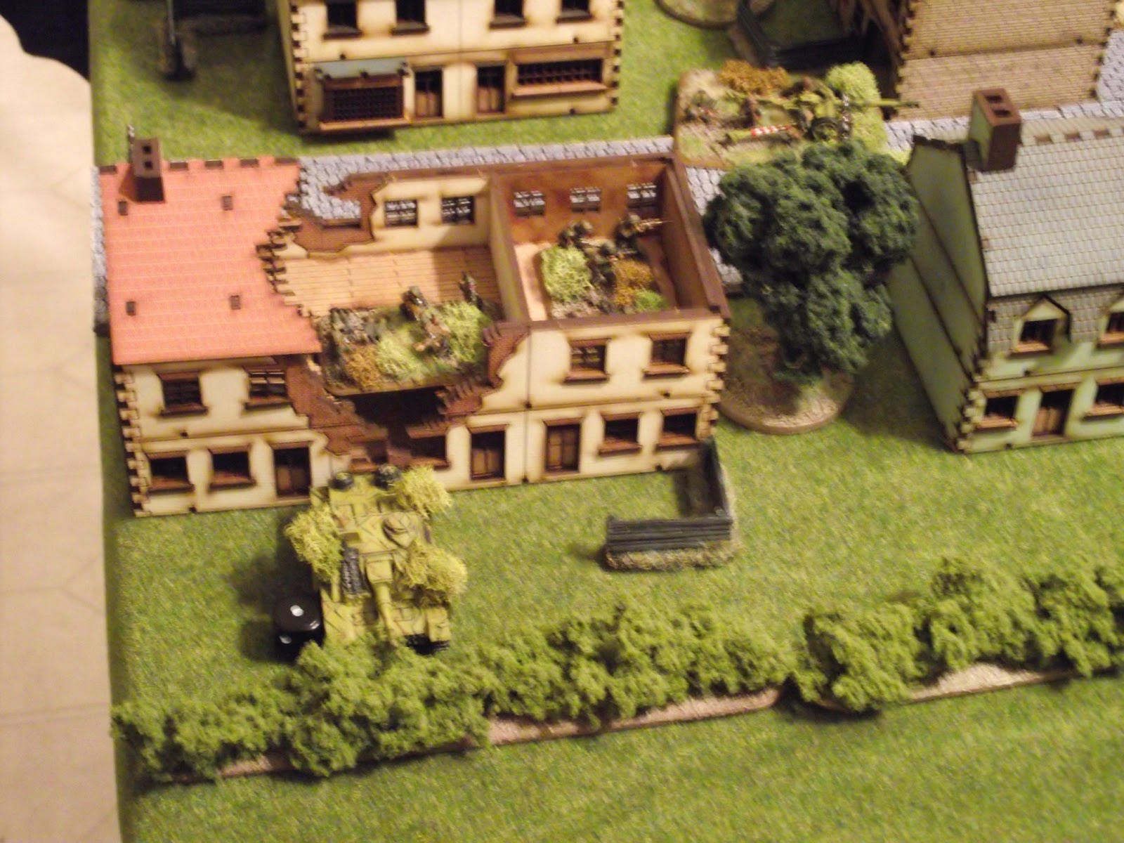1st squad of 1st platoon retreats all the way to the town and enters this building to set up what defence they can.