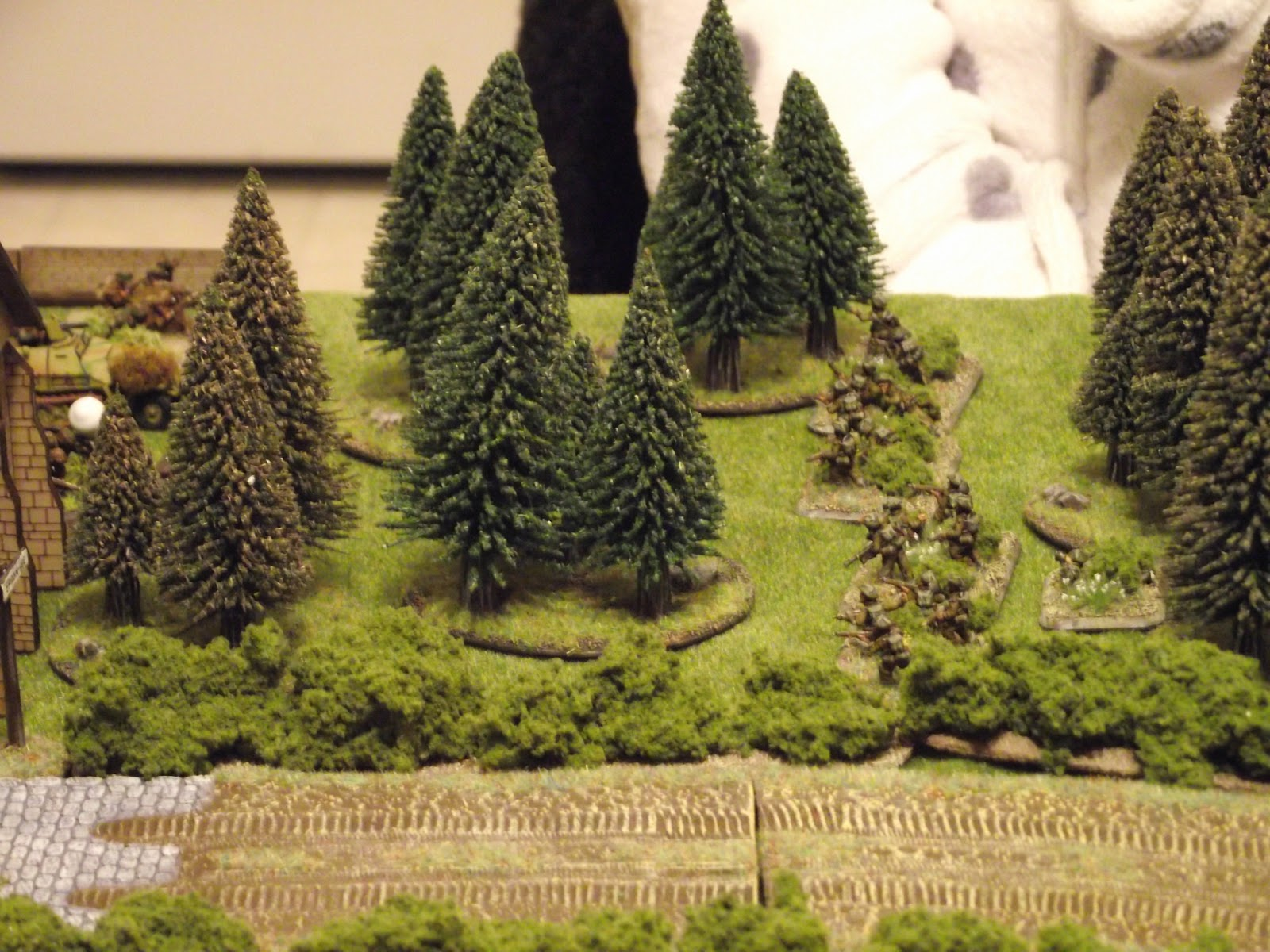 With the success of the last few turns, the British 2nd platoon starts to rush towards the church in the hopes of taking out the tank hunters in side.