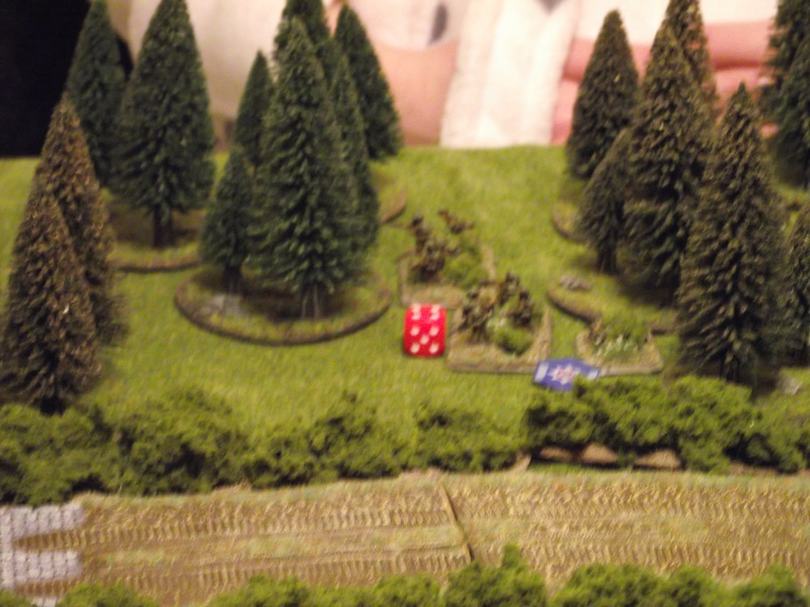 They are met with lots of MG fire and take massive causalities. It was a mistake to get them within 9 inches of the enemy without lots of covering fire, or a couple of tanks as support. My mistake, and I paid for it.