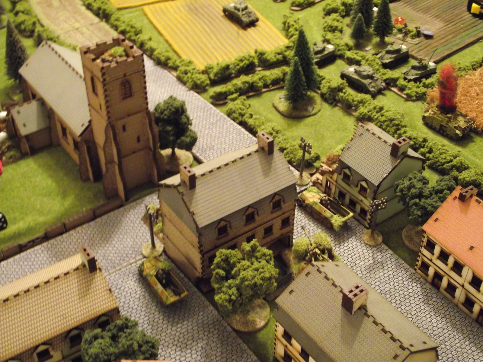 Another German squad enters the Hotel across from the church and sets up on the second floor.