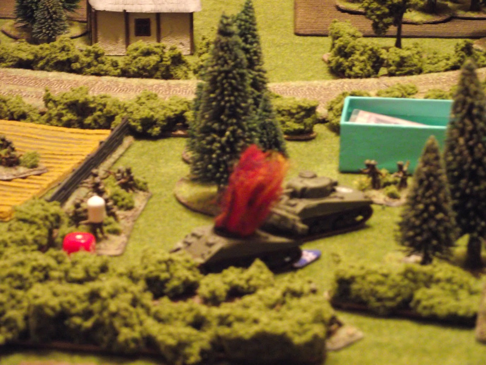 The remaining Sherman backs off, raking the church with MG fire while doing so.