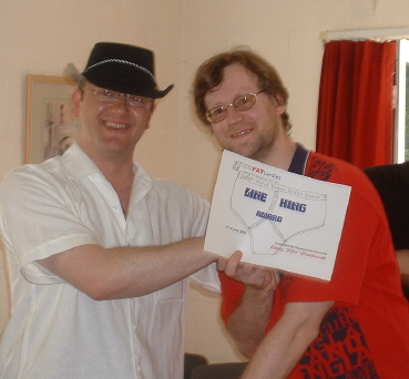 Sid presents Mike Brian with an award for clearing a minefield, after he has run through it twice!