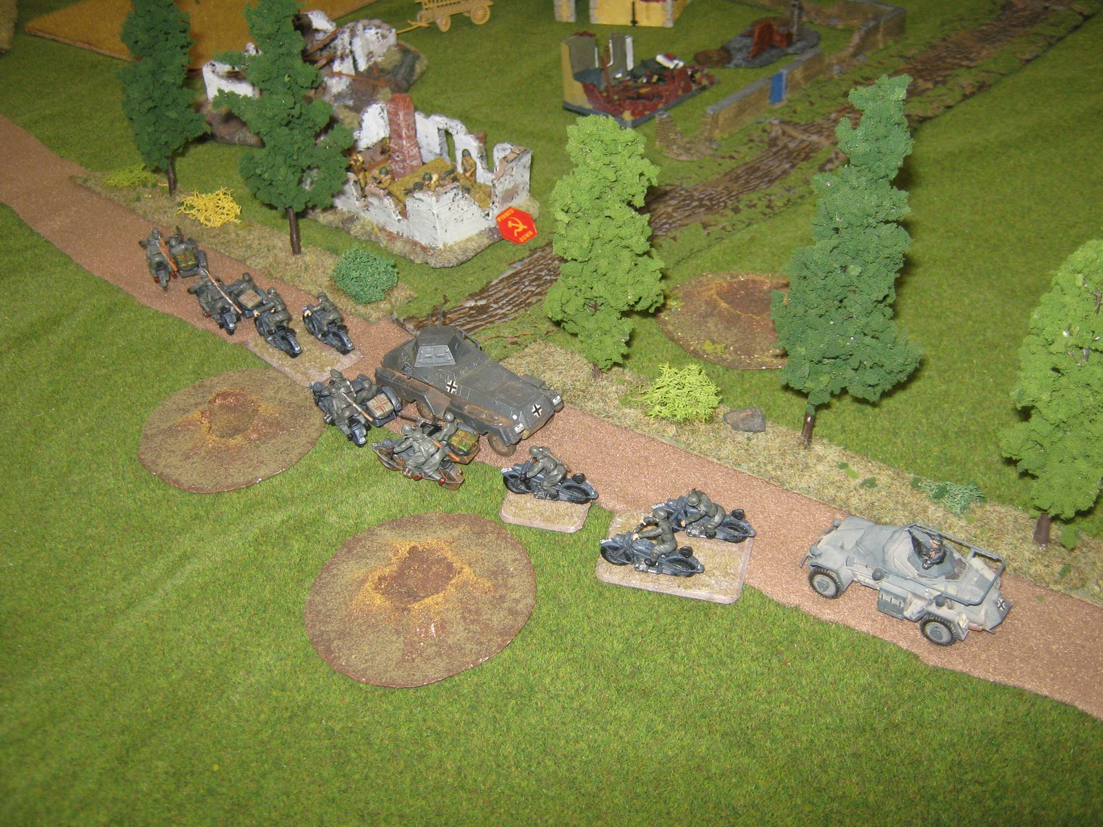 A few ill-equipped men stops the mighty German army. Notice the small armoured car, a PSW 223.