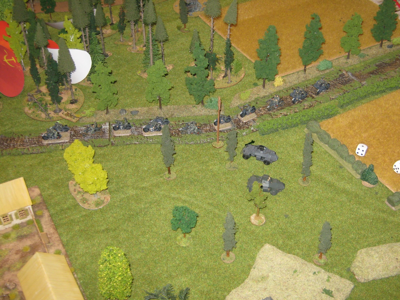 A platoon of motorcycle infantry drives happily forward. Ignoring a lone anti-tank rifle-man.