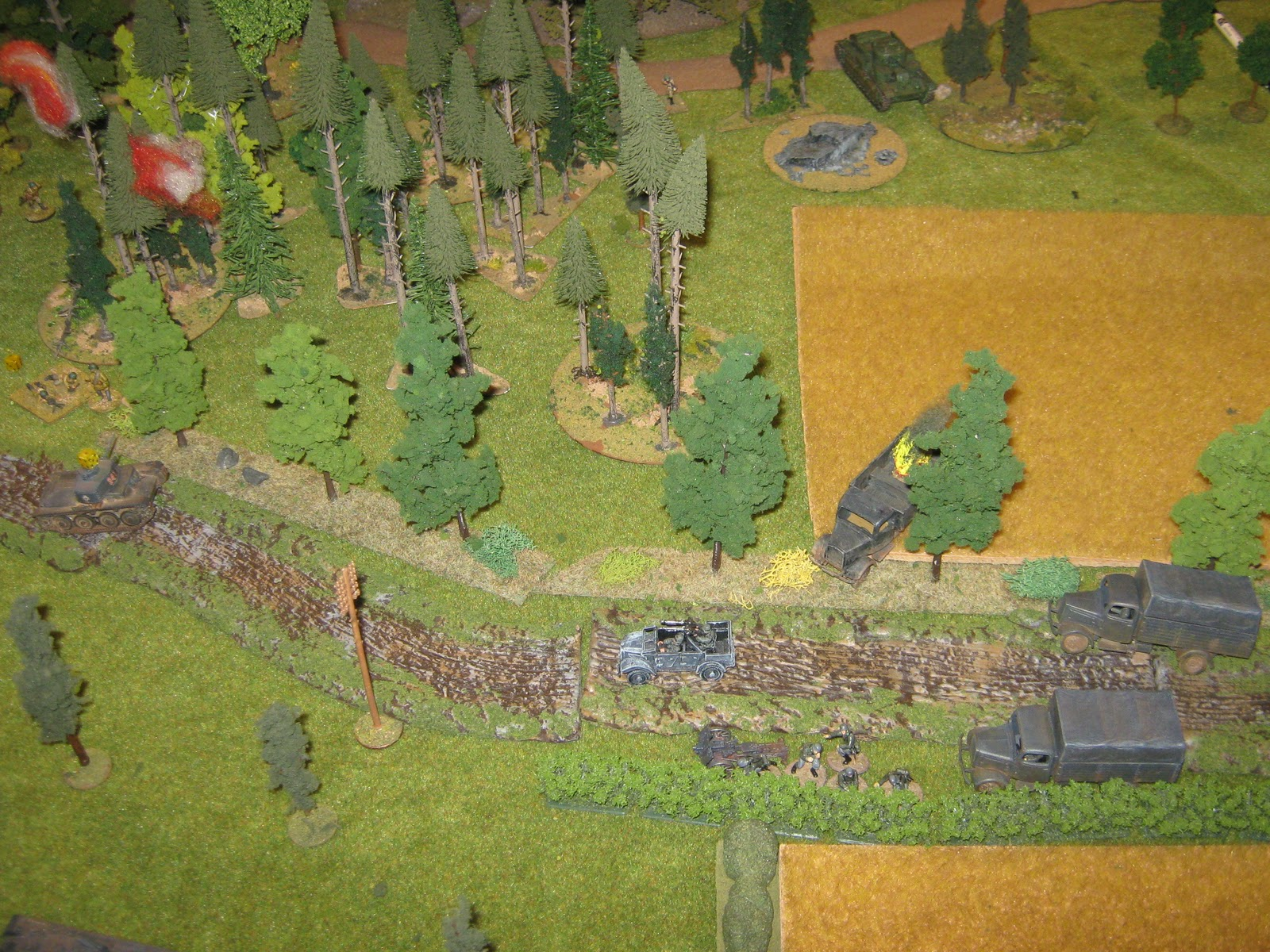 At the same time, the Russian counter attack hit the right flank, now with a T-28…