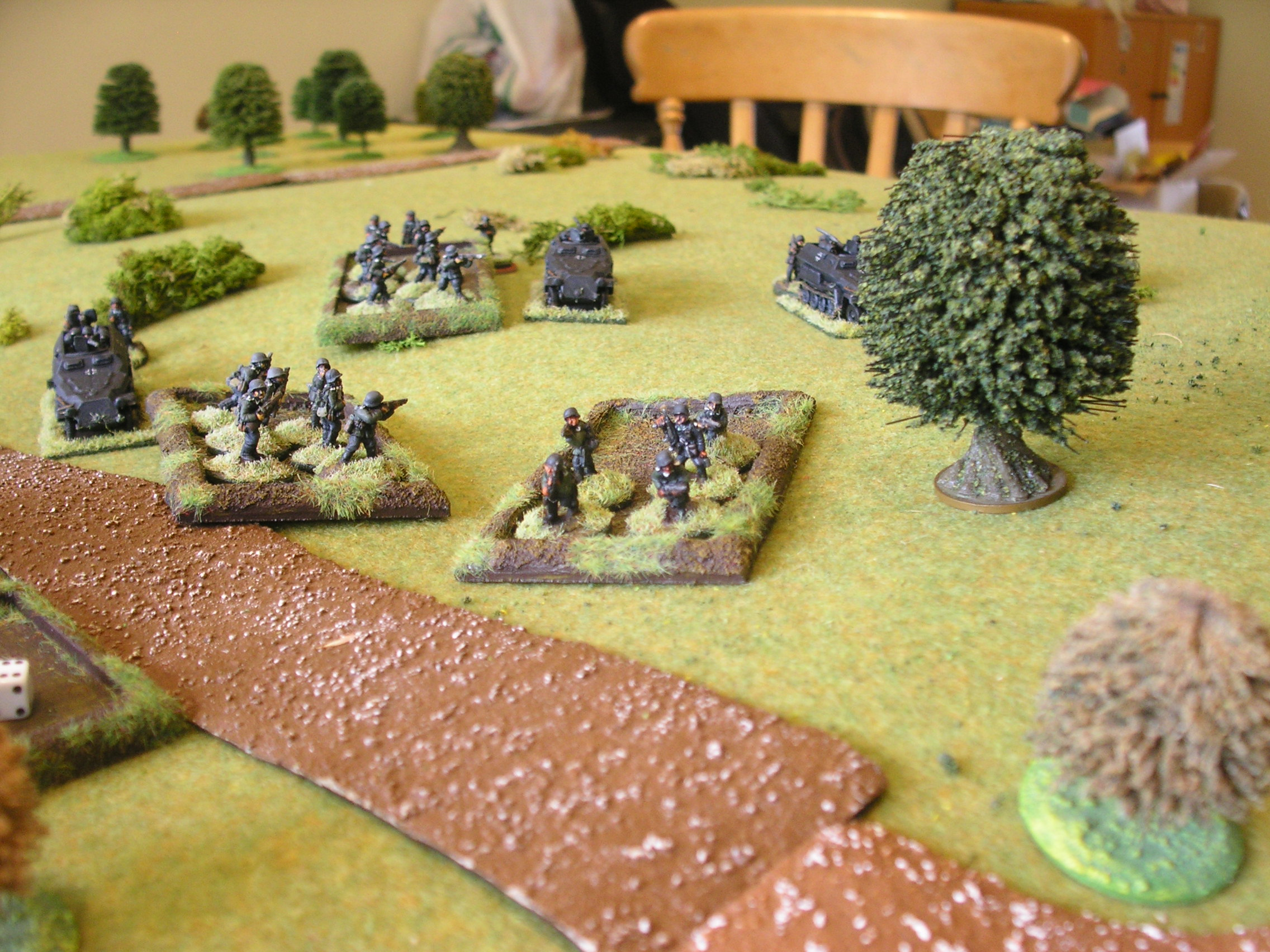 Before: down the hill go the German infantry