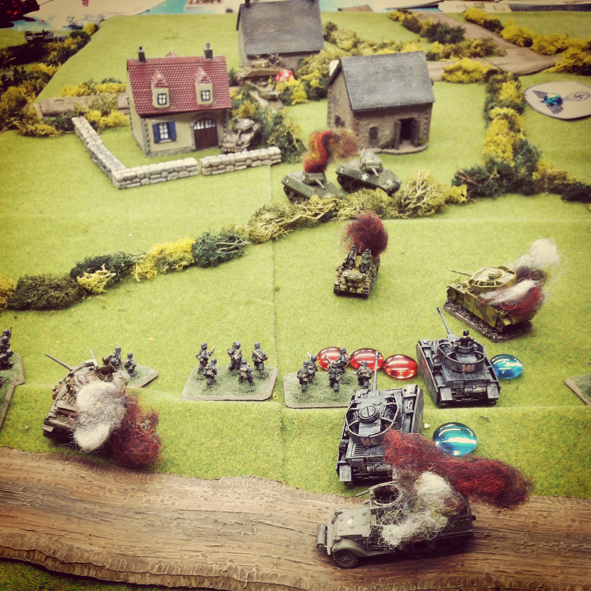 US and German armor exchange fire, leaving a Wespe, Panzer III and M10 Wolverine in flames
