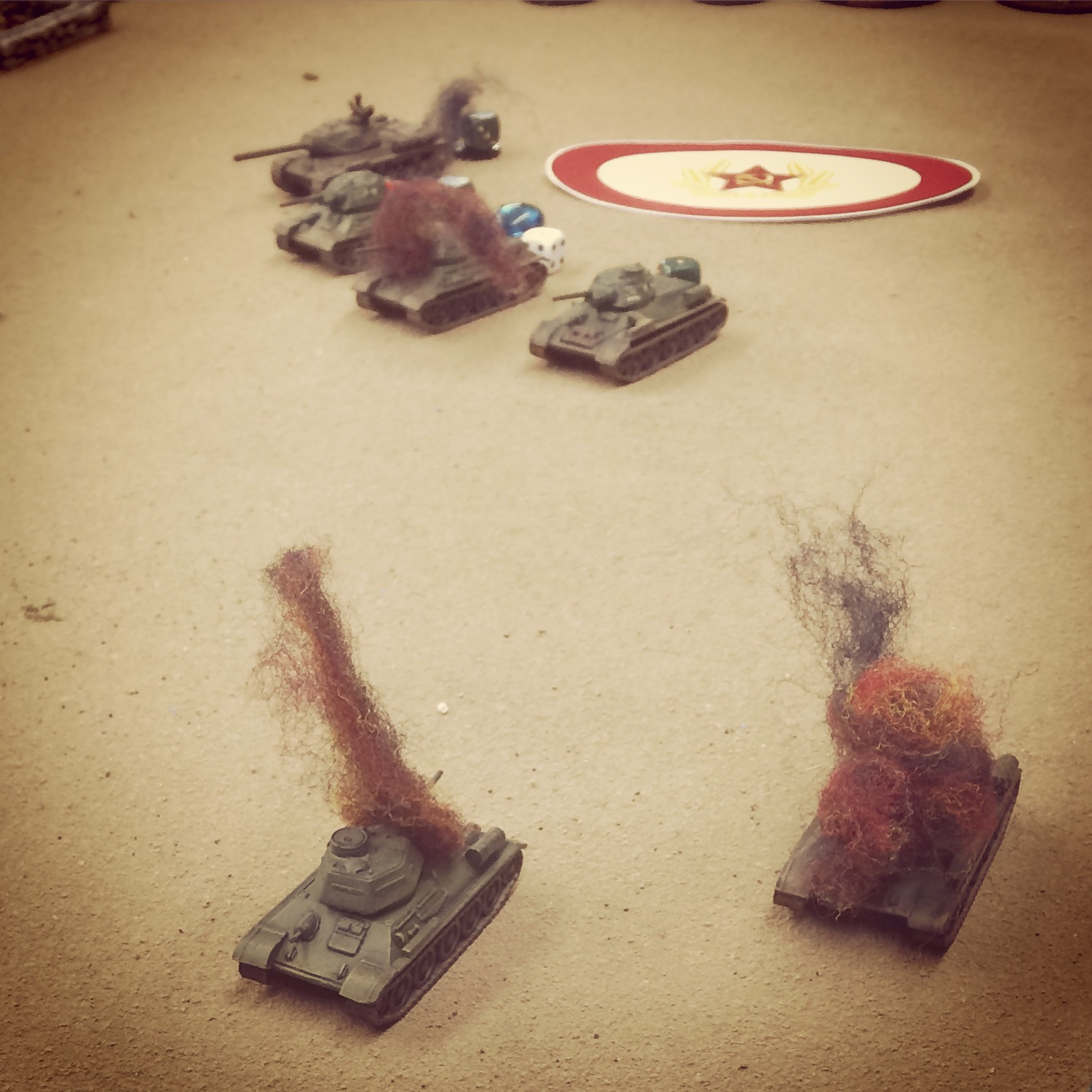 The first wave of Soviet armor burns in the field as reinforcements arrive on a blind to the rear