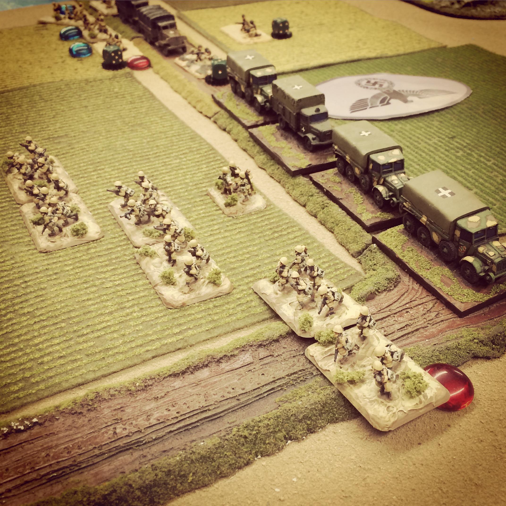 Italian rifle platoons sprint ahead through the open field