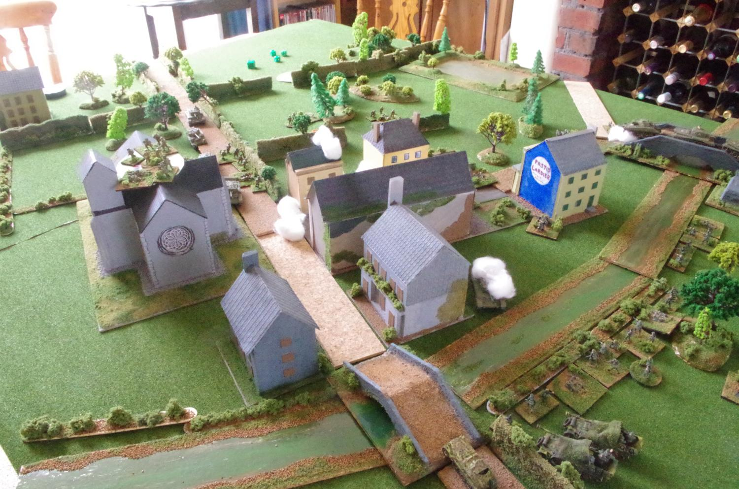 The British get bogged down as the village starts to burn