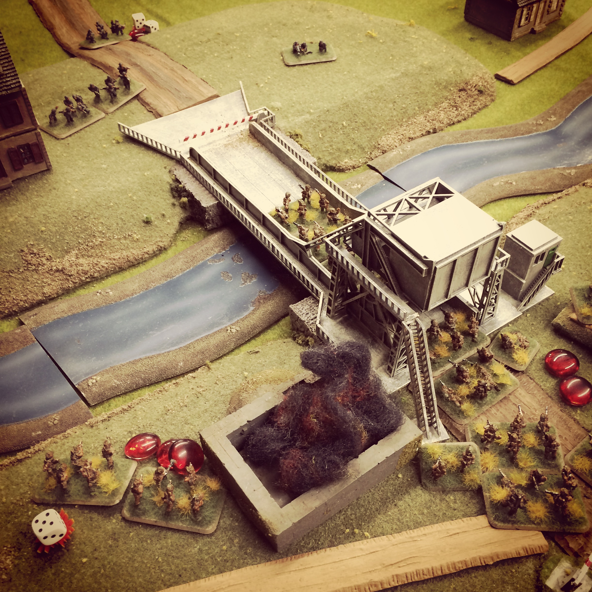 The bunker burns, the British head over the bridge but take shots from German snipers