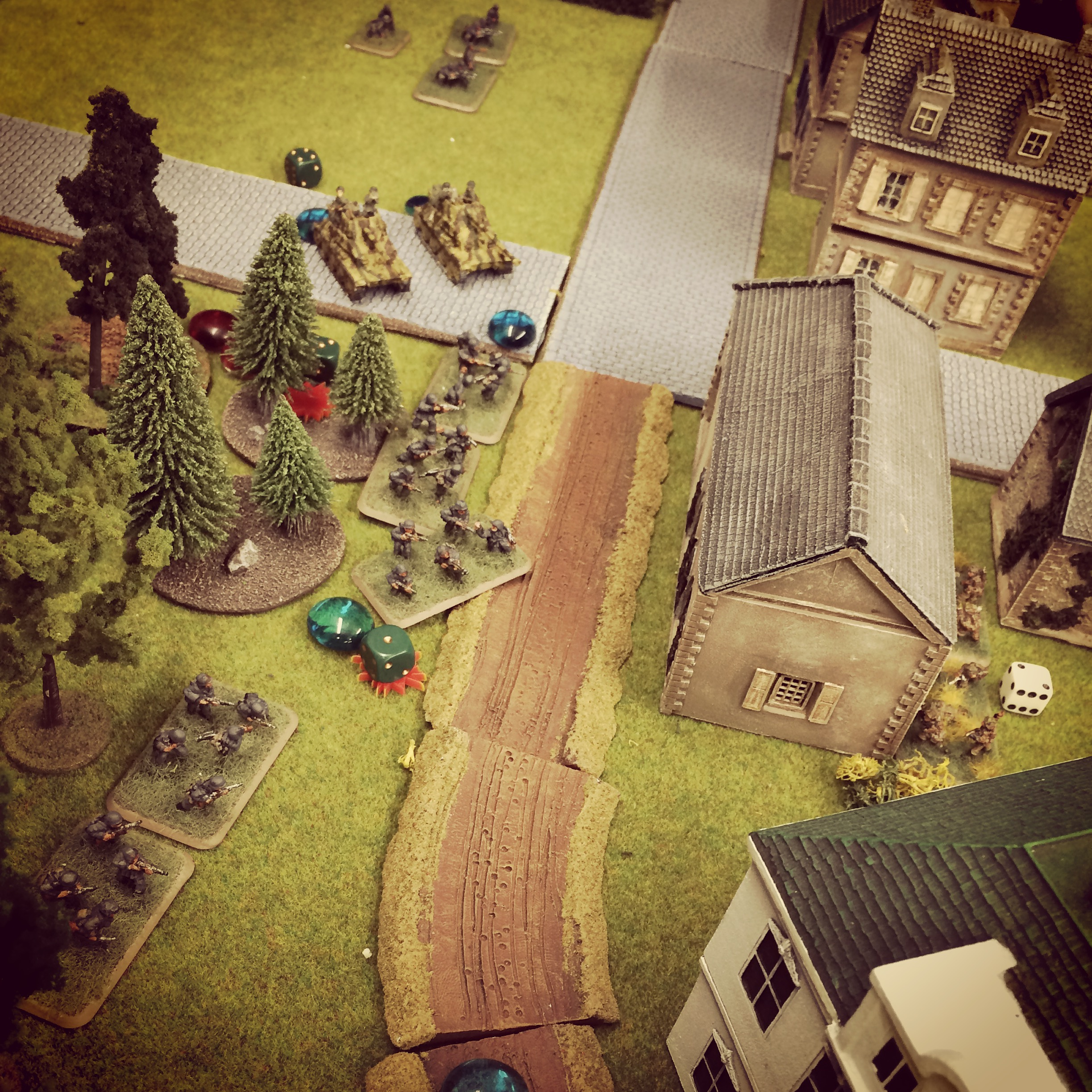 German troops advance on the town supported by mobile guns