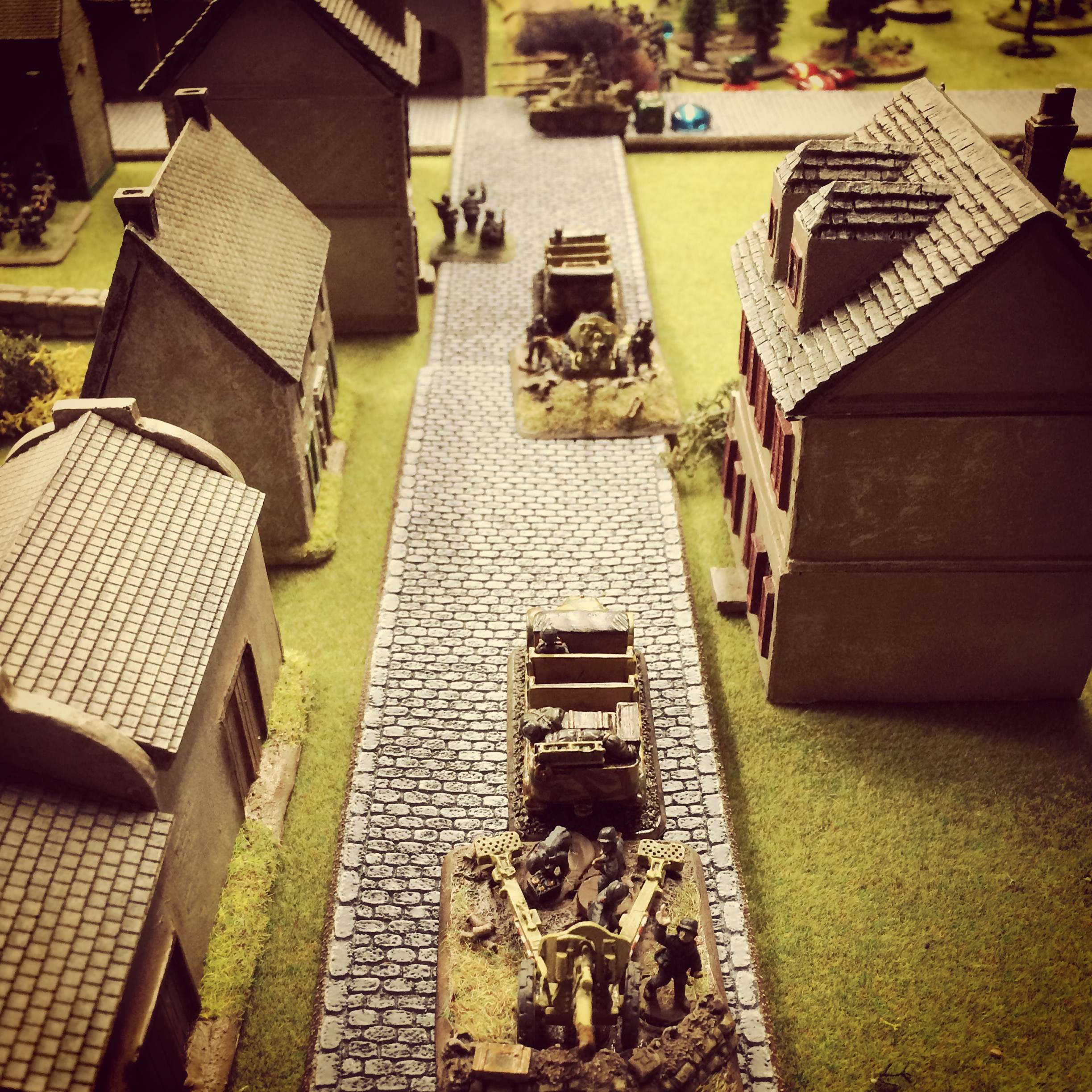 German artillery is towed into the town
