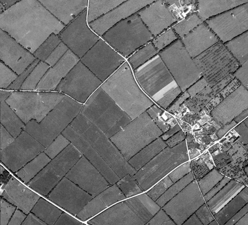 US aerial photo after the war showing the village of Poupeville, its road pattern and the outlying fields