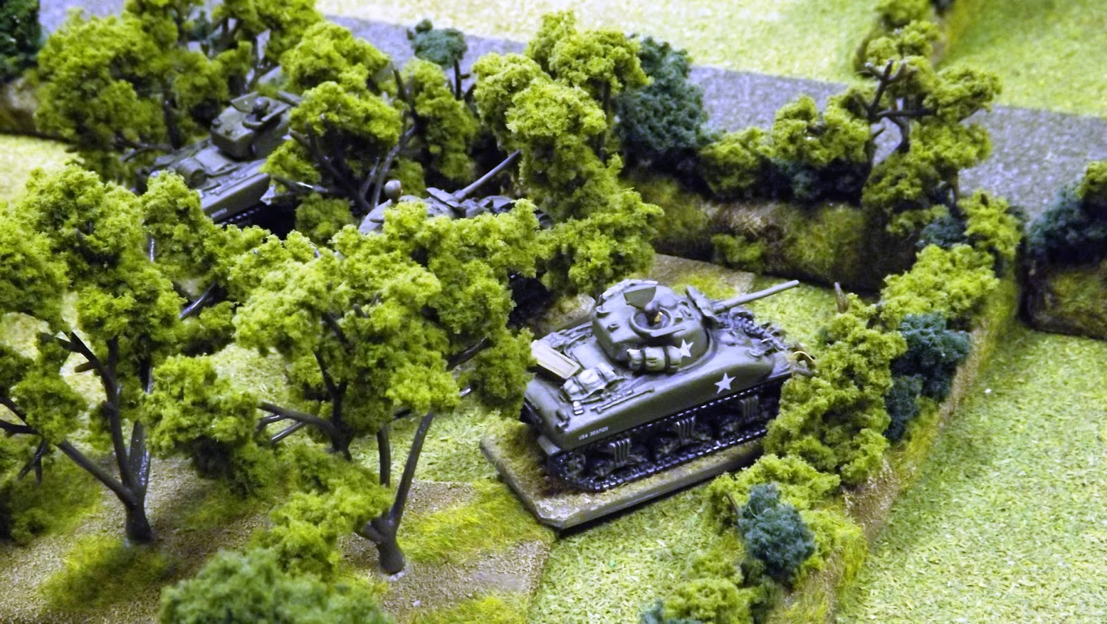 Much needed reinforcements from Utah beach as the Sherman tanks of the 70th Tank Battalion crash into town and join the fight.