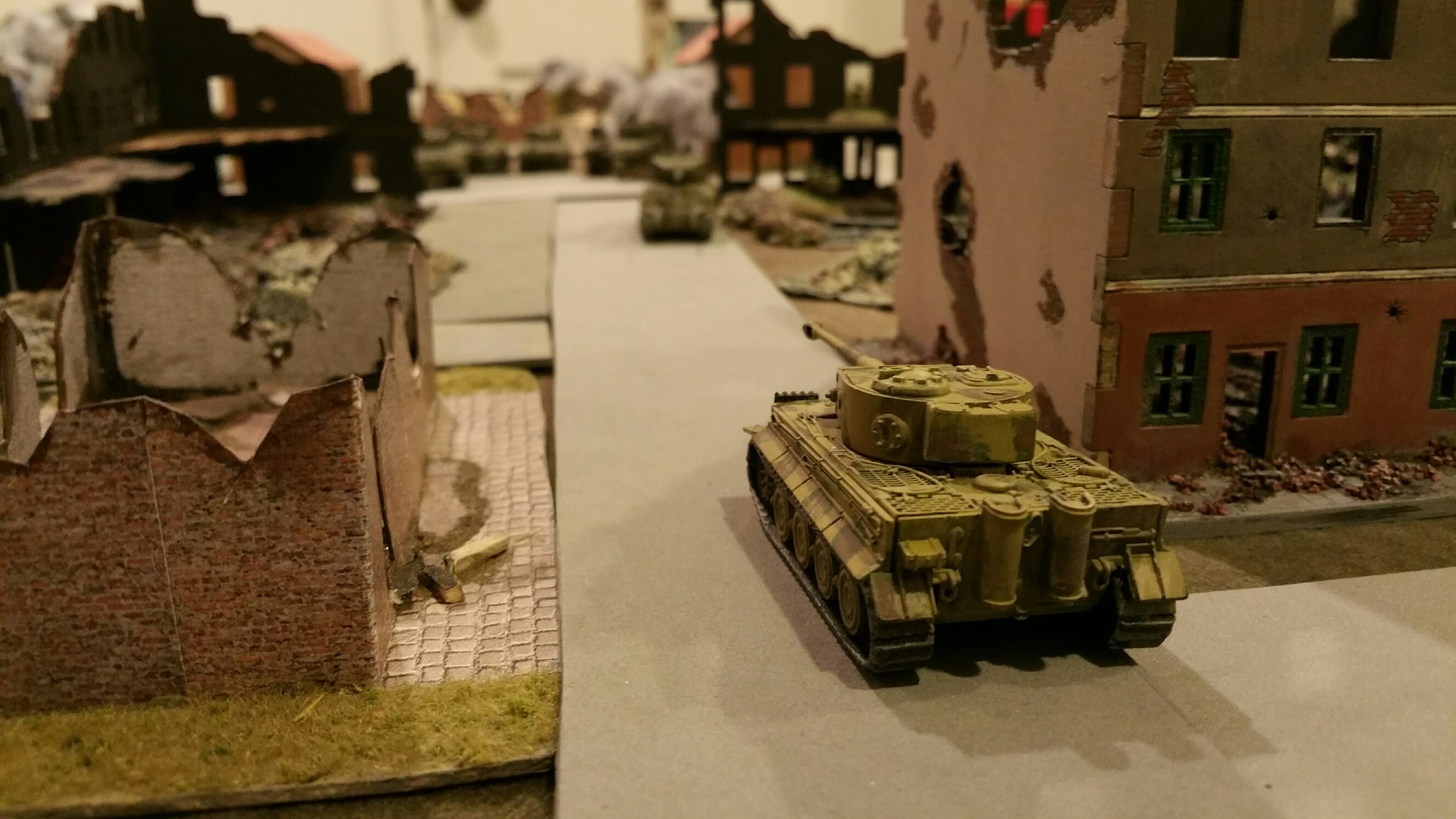 Two Tigers started out and one got bounced by a P-51 and blown up but the other continued around the US right flank and into the rear of town for a face to face dual with the sole surviving big gun Sherman. Guess who won...not Brad Pitt.