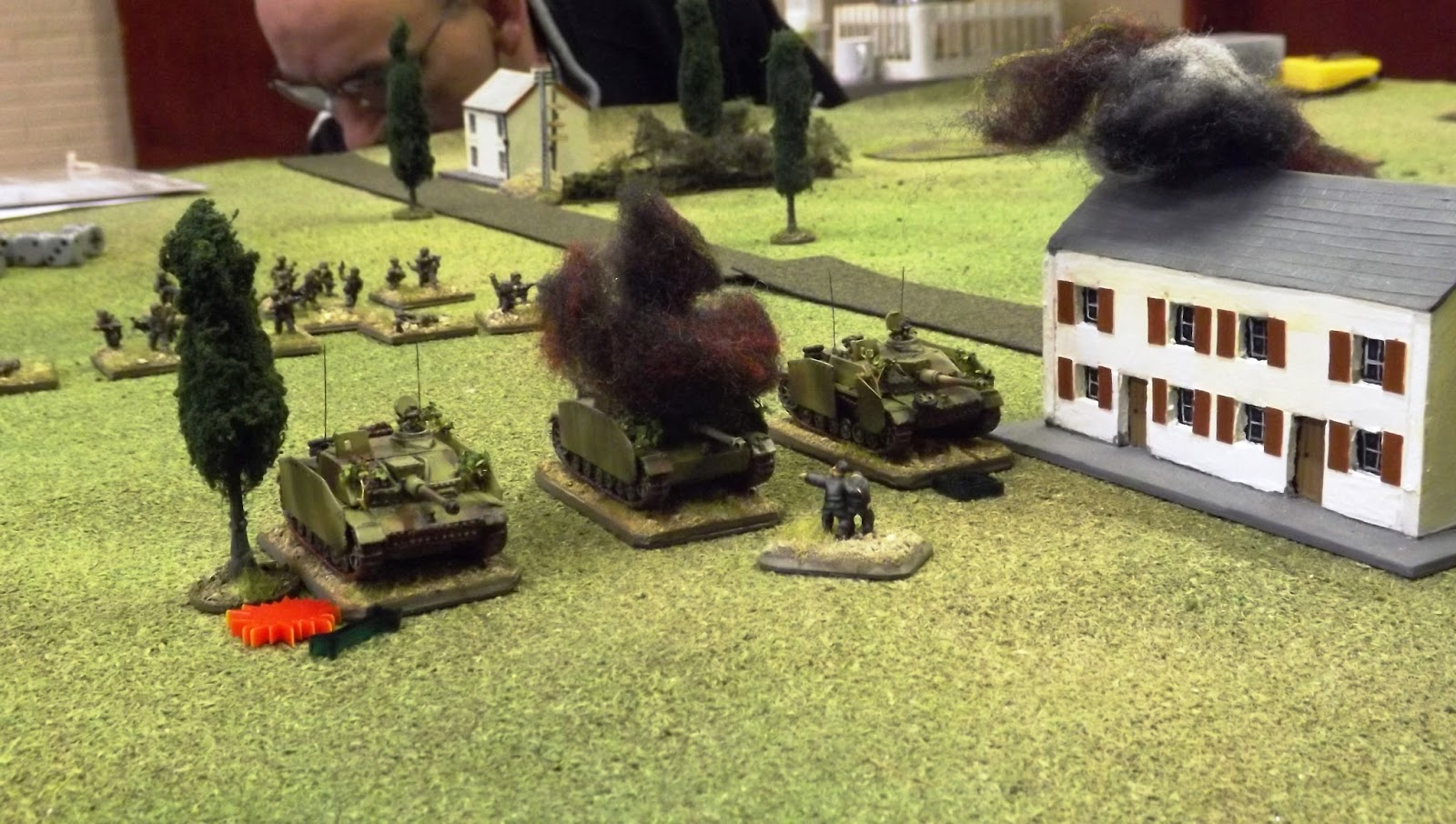 The StuGs feel the effect of the 6lbr with the one in the centre knocked out, the one on the left immobilised and shocked and the the right most vehicle with a damaged main gun.