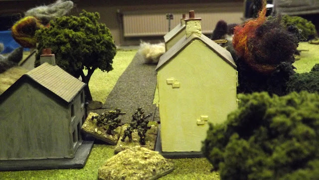 11th Para infantry are forced to move from building to building as their position comes under intense mortar and StuG high explosive fire, setting the houses alight