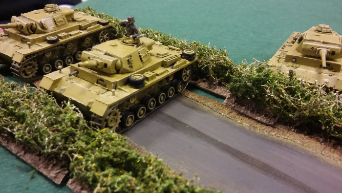 German armour spotted on the left flank. Lovely Pz III models (PSC I think?).