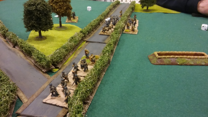 German return fire clears the trenches, and the advance continues.