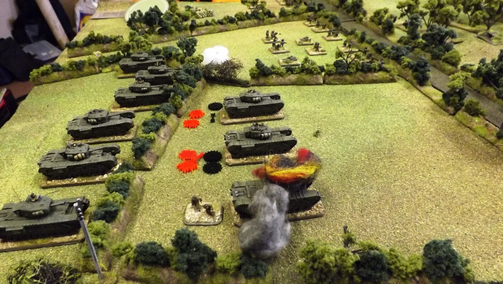 The lead British tanks take casualties, shock and damage as the Guards infantry sprint to the sunken lane