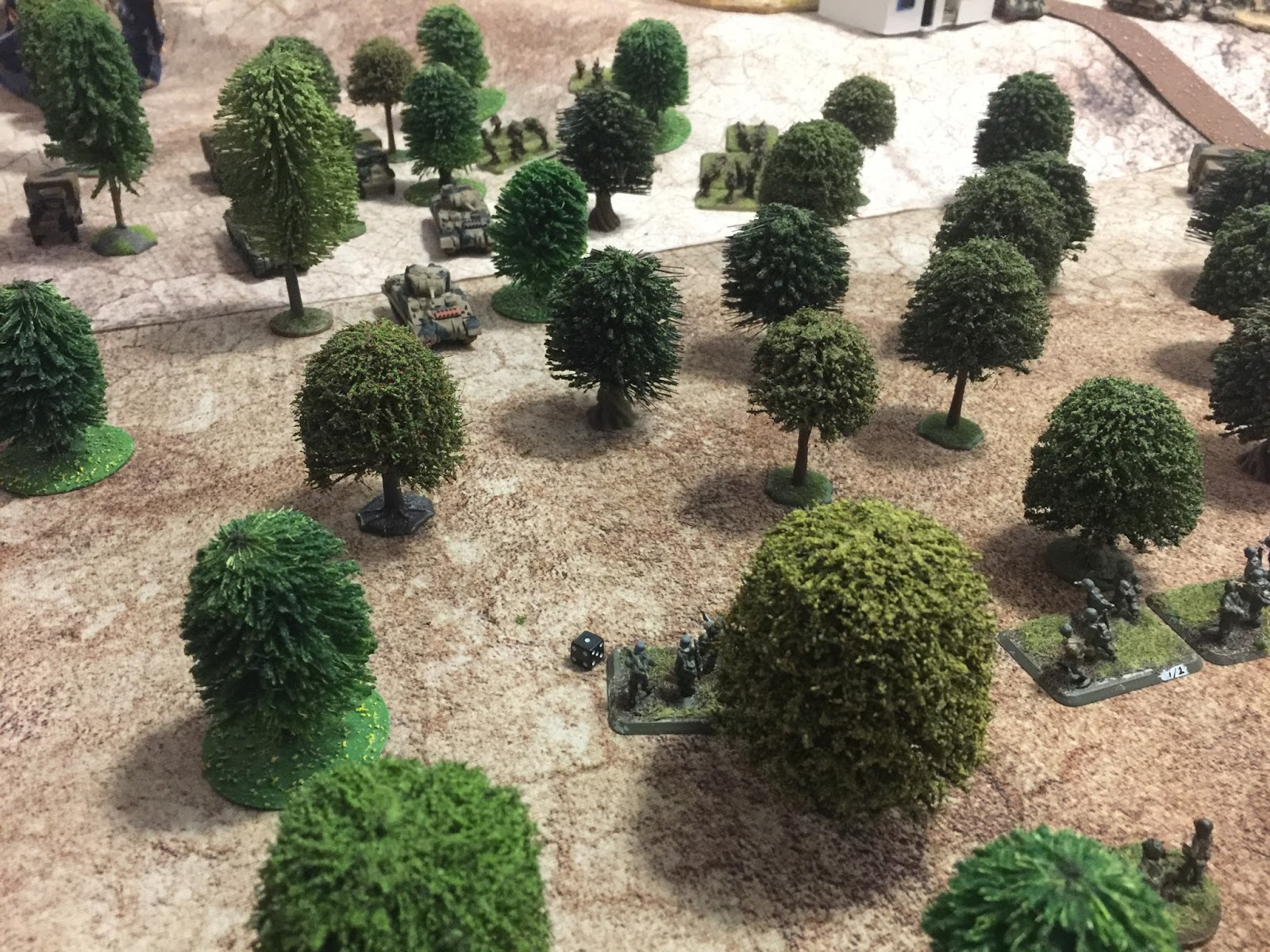 A troop of the 16th/5th Lancers are forcing their way through the olive grove. The German Zug is rather regretting its decision to re-enter the trees.