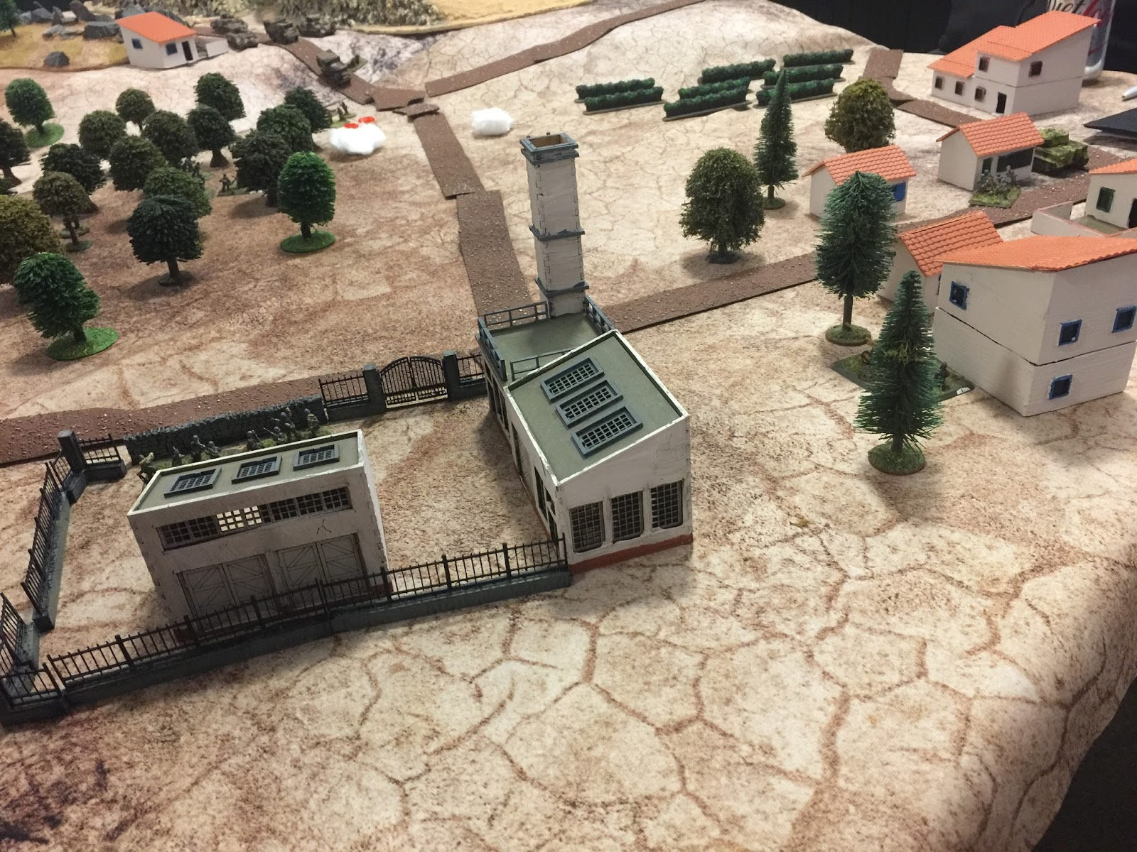 The fun's already started, as a section of British 3 platoon, sent out in advance by the CO to see what's afoot, has dismounted from its trucks,wandered into the olive grove and just about fallen over two sections of the German infantry Zug. It was rather rapidly reduced to 0 actions.