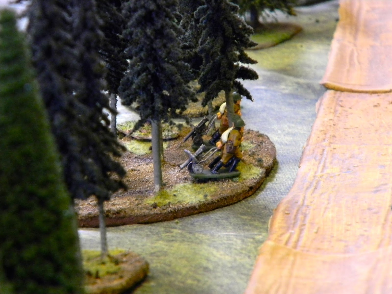 As Soviet machine gunners drag their pieces into position amongst the trees.