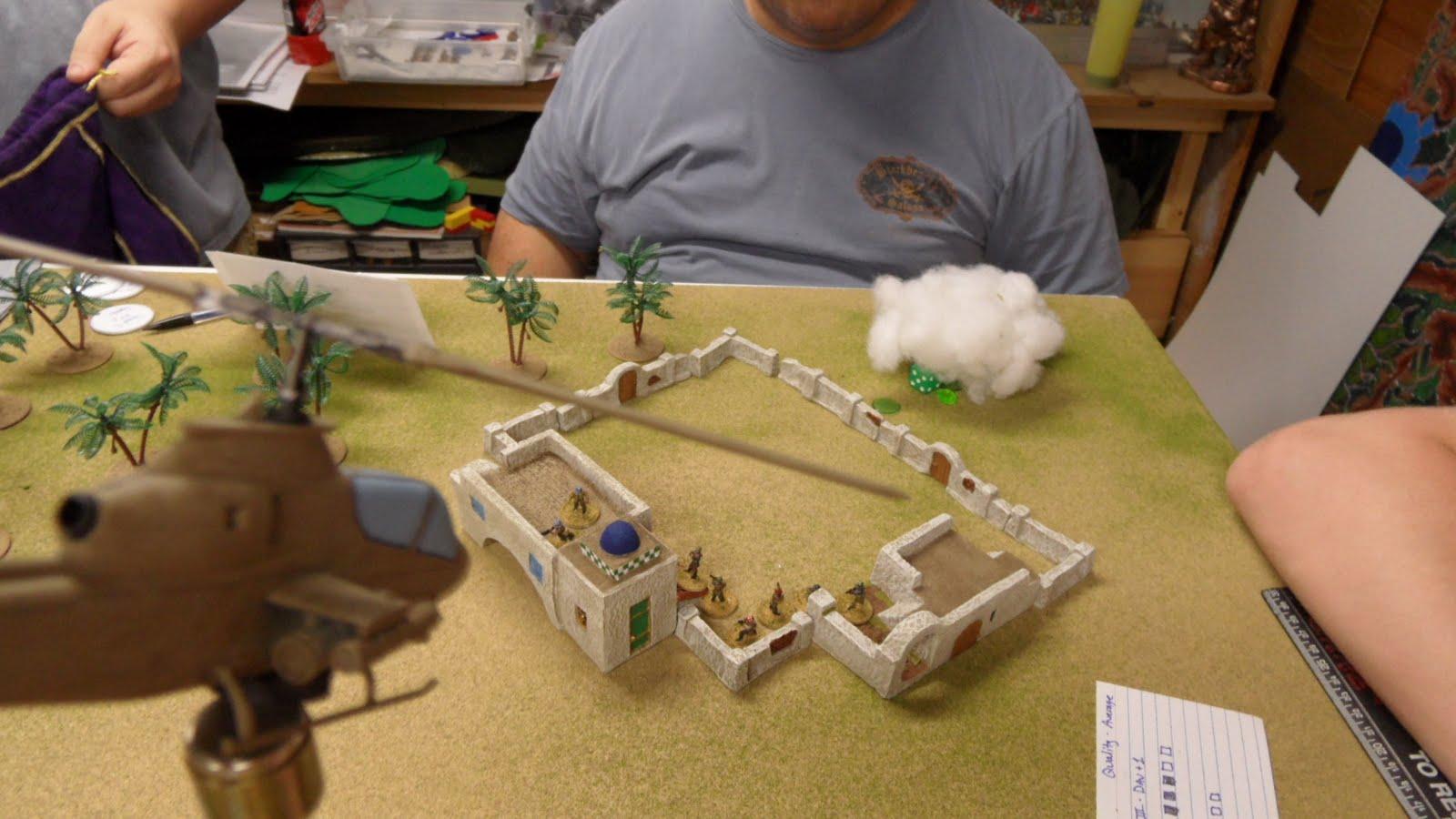 A Cobra gunship takes the compound under fire