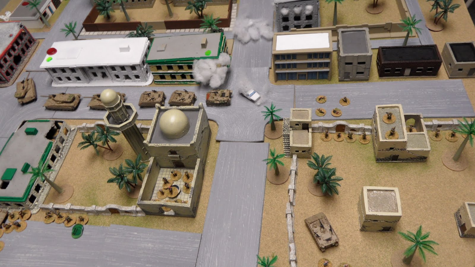 The Merkava Platoon makes its way past the torn-up intersection, looking for the RR...