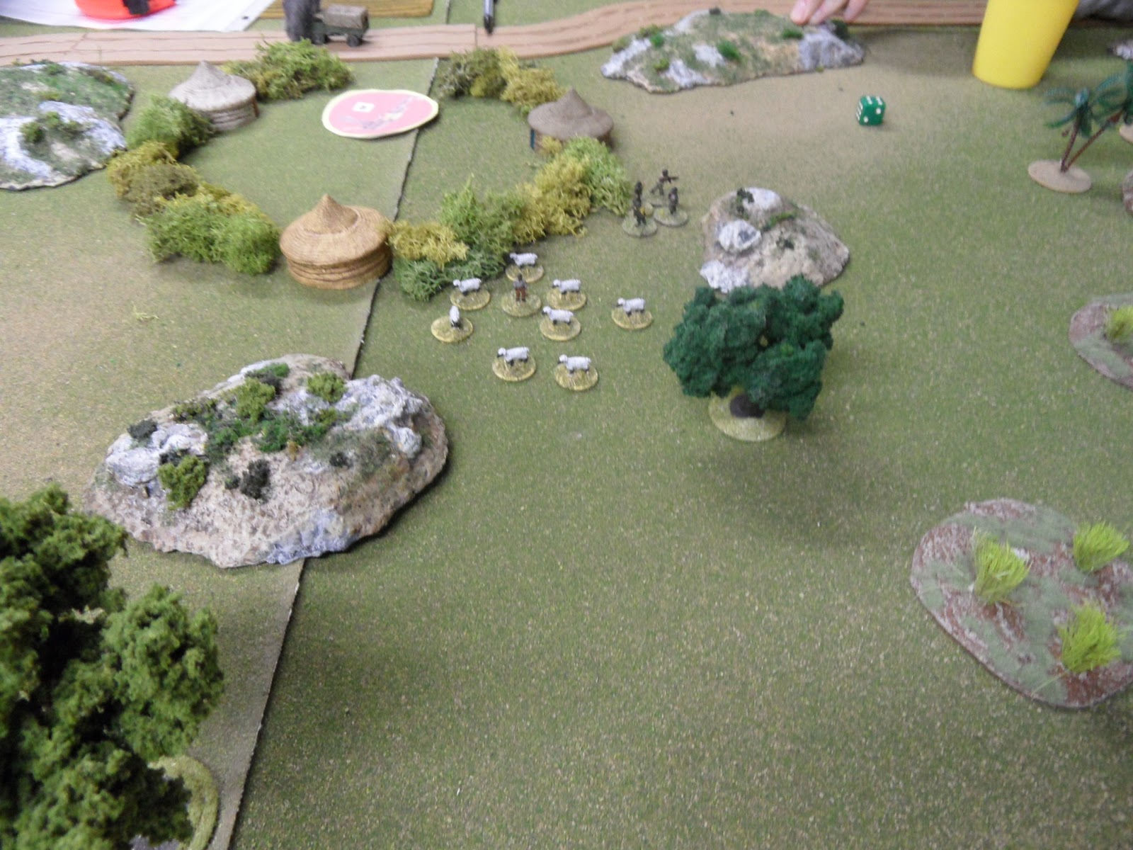 Fearing the retribution of the rapidly advancing R.L.I. the RPG crew fled behind the village  causing the shepherd to try to find a less hazardous area to graze his flock