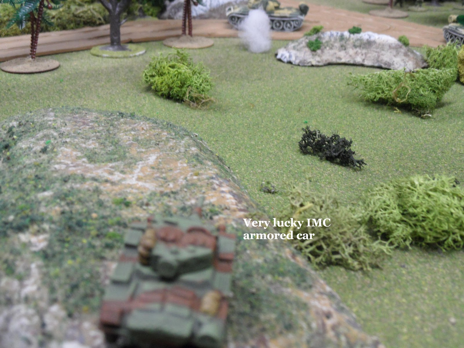 The T-55 misses the armoured car for a third time.