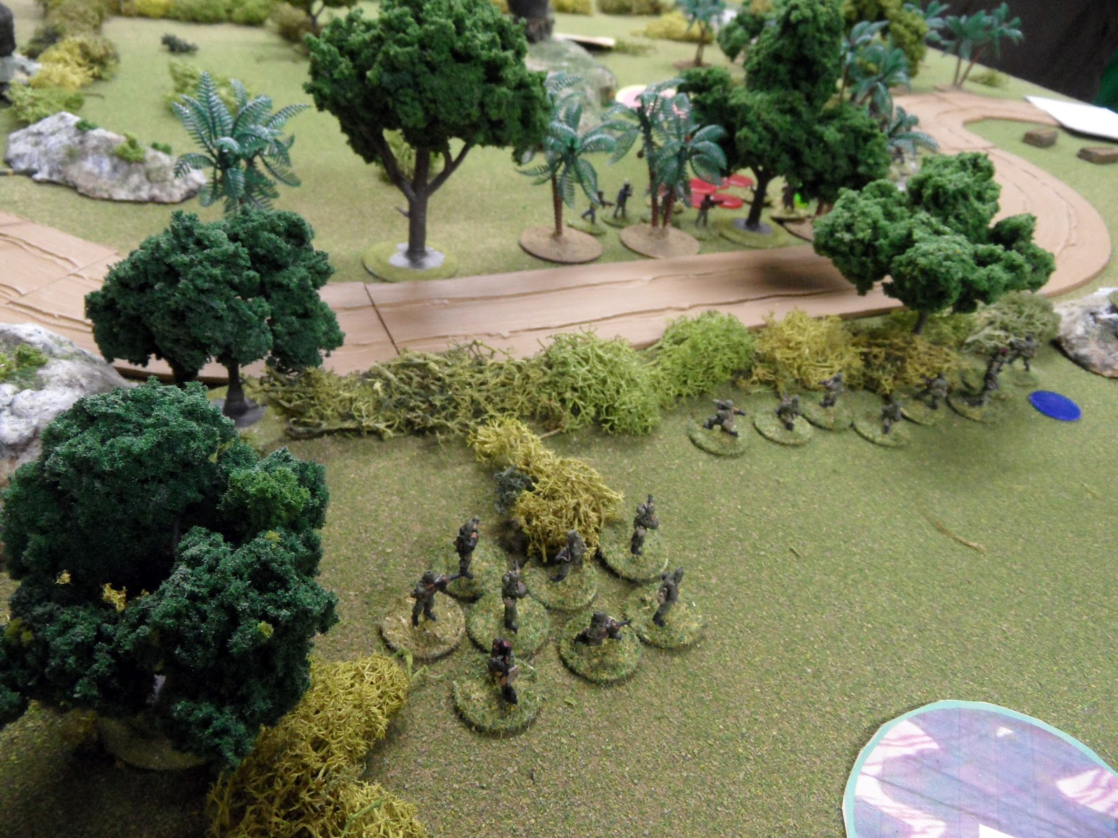 More Government forces advance to drive off the stubborn rebels in the tree line.