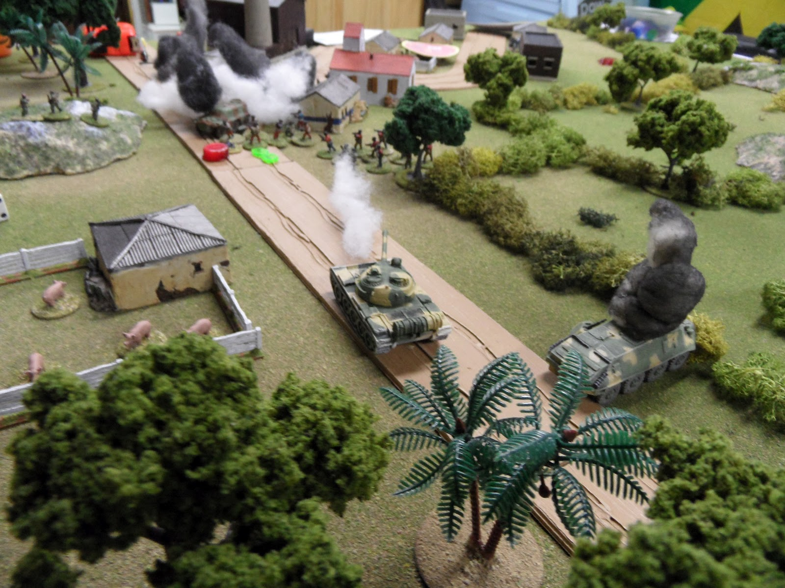 The rebels vainly fire an RPG at the T-55, and are subjected to return fire for their efforts.
