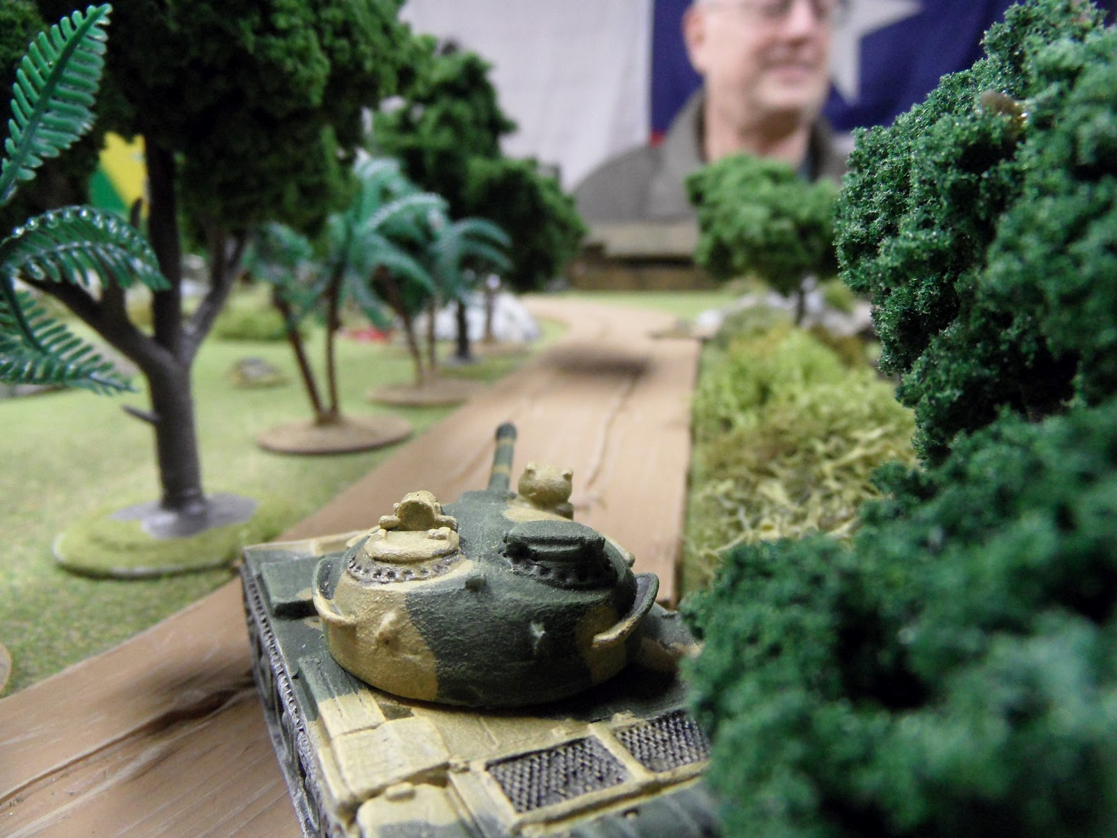 The T-55 spots the troublesome technical near the sawmill and takes a very difficult shot...