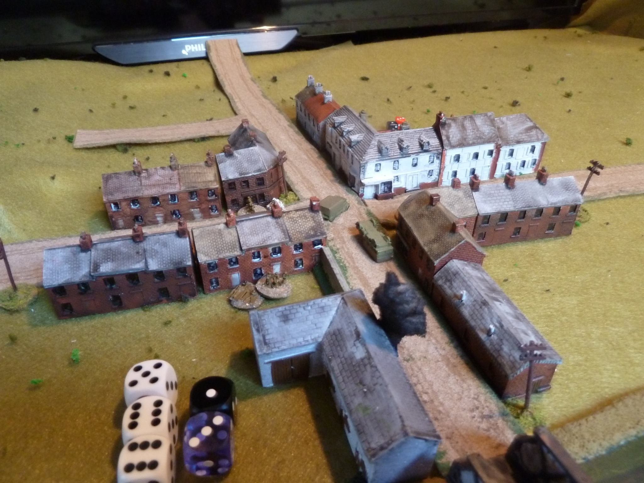 A Boys ATR shot rings out from the white corner house hitting the lead Pz I and a great roll means the end of Panzer Leader 1!