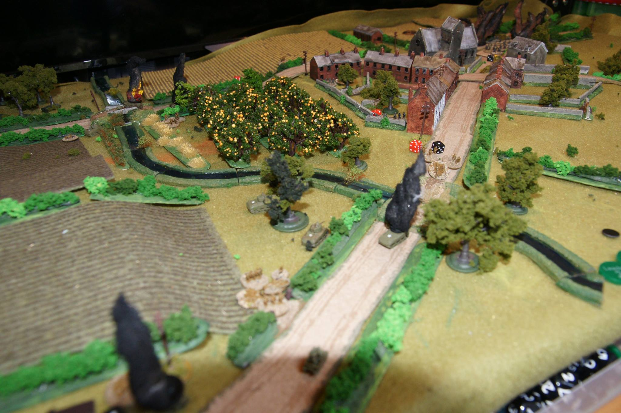 A shot from the western bridge showing the Panther causing chaos. It has just finished off the second Firefly (blur of smoke at bottom left); and the section that dashed over the bridge got hammered by the German squad covering it. Should really have used more smoke first! Again, the attack has just been ground down.  Good game, but I really need to work on my combined arms attack tactics: Major Tree fails again :(
