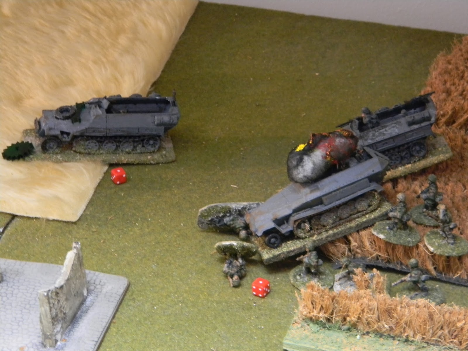 Bang ! One half-track erupts in flames and another has taken damage too.