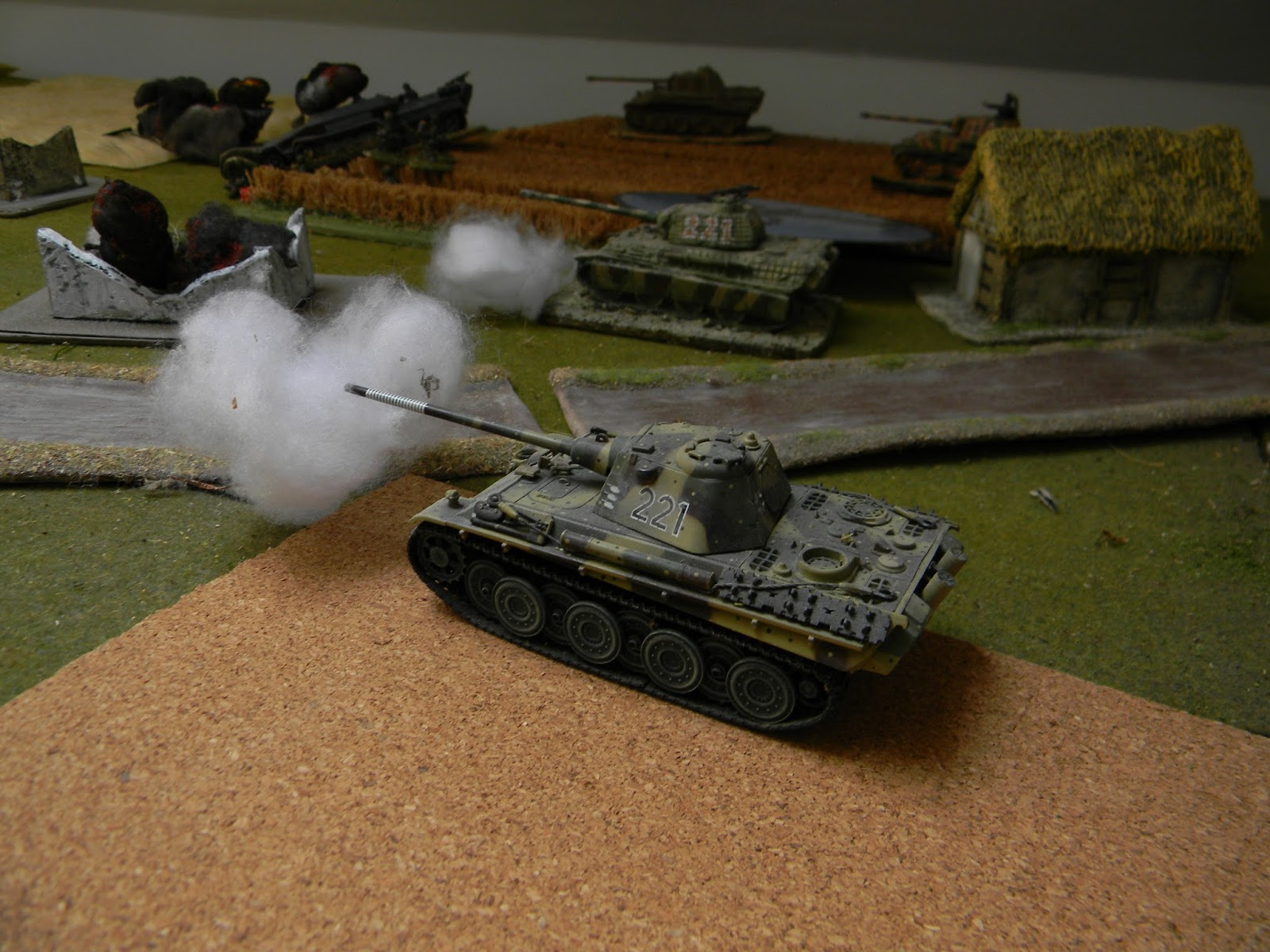 Two Panthers move into town and also aim at the enemy guns