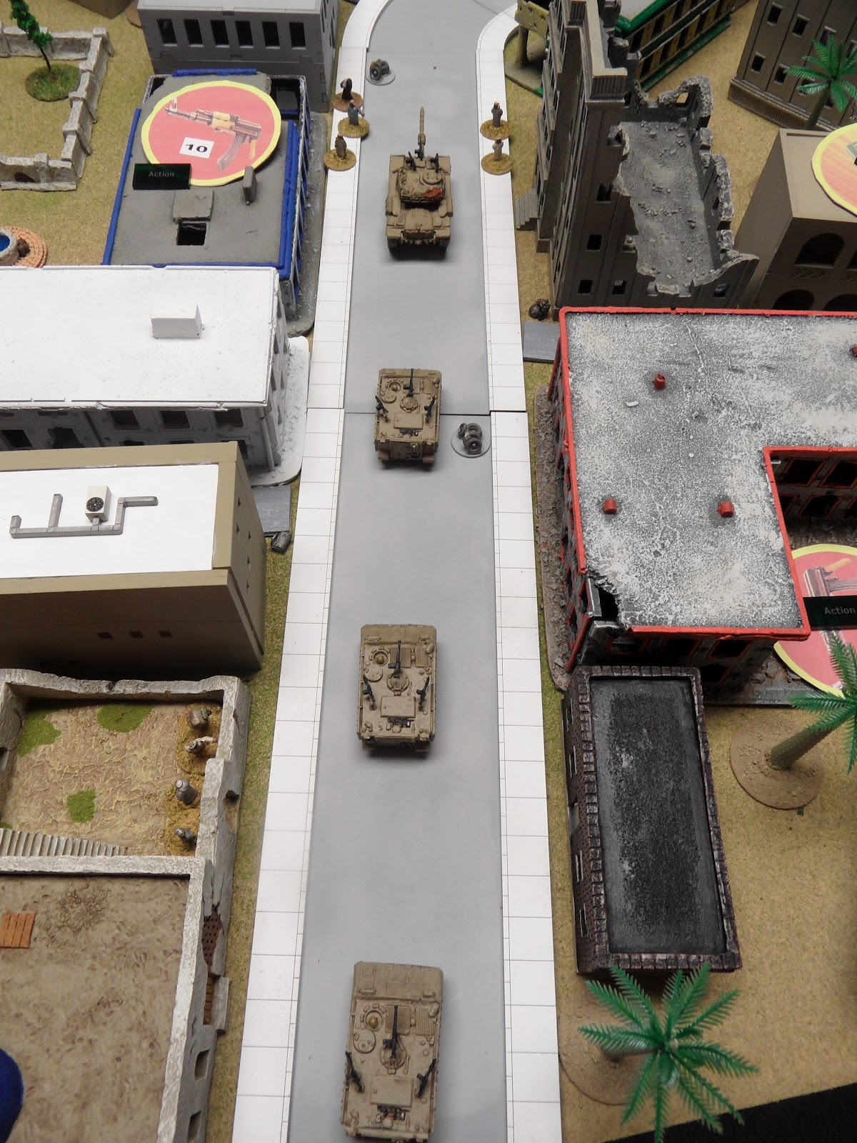The convoy trudges forwards into the kill zone...I mean, refugee camp.