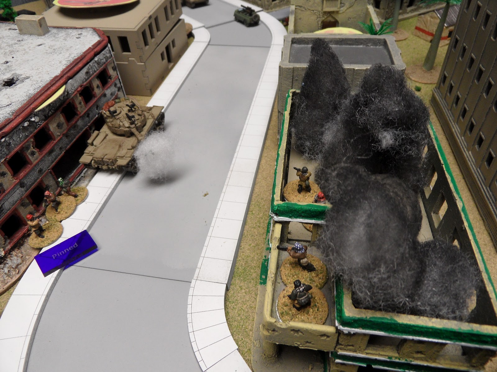 The Magach lights up a second building, wrecking that one as well.