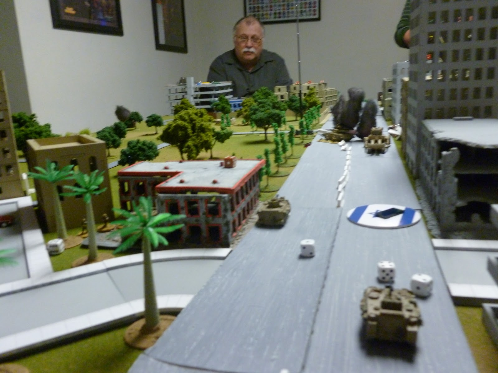Old Sarge contemplating the mayhem from the PLO end of the table.   A couple more RPG hits and the 'dozer will surely block the opening it just made in the barricade.