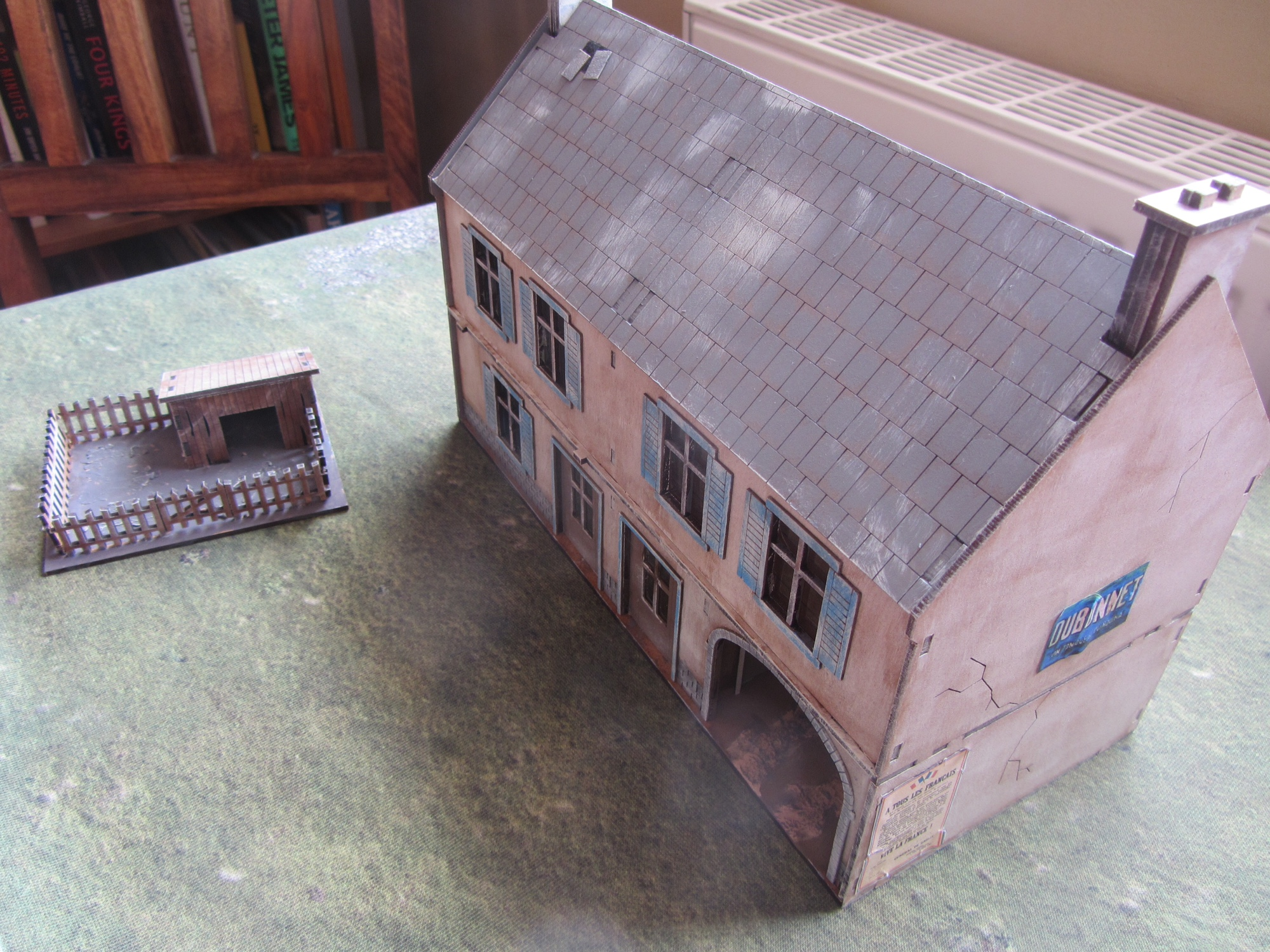 A rather nice Sarissa farmhouse, and a pigpen from Warbases, both from Mervyn Douglas