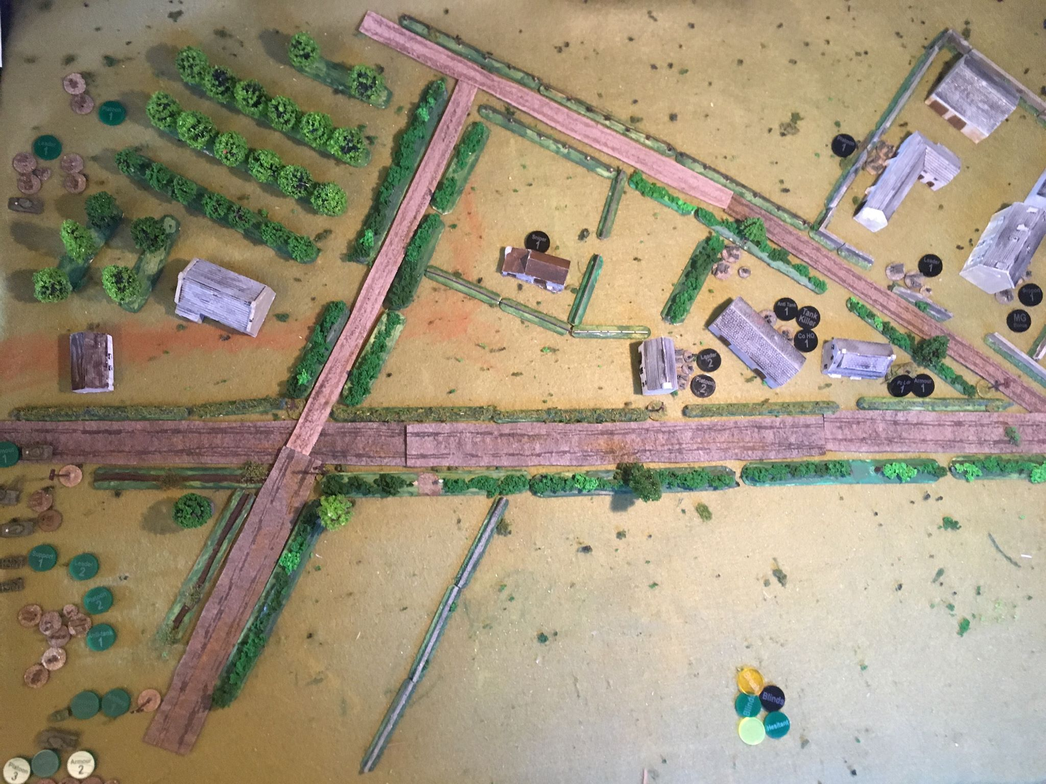 The German dispositions are shown below with No 1 Zug in the walled farm with the MMG upstairs in the farm house giving fields of fire over fields on their right flank and into the orchard.   No 2 Zug is in the village buildings in the centre and the lone Tiger (with Panzer Leader) lurks behind the building near the junction on the right.  Some of the hedges are mini-bocage, some are just soft cover.
