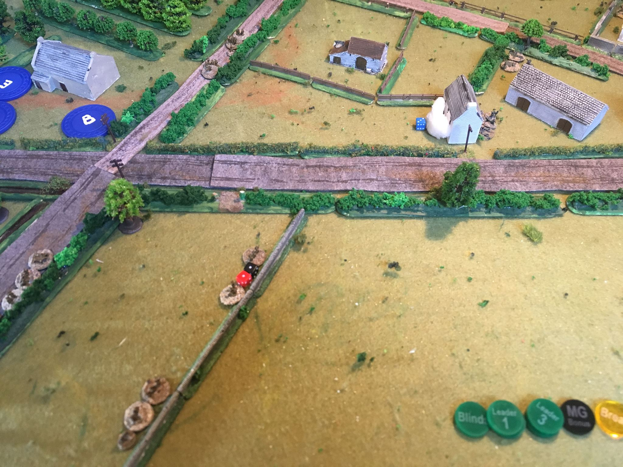"A short turn. The Germans have opened fire from the house in the centre.   The Brits' 2"" mortar drops smoke bang on target in front of the house blocking fire from this key position. Fire from No 1 platoon kills the sniper: the terrain meant he was a little close when he opened fire and was easily spotted."